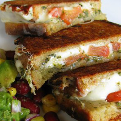 Bidding adieu to Grilled Cheese Month and ushering in a colorful spring with a Mozzarella Grilled Cheese Sandwich, with Avocado Salad.