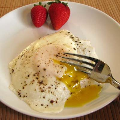 The secret to a perfectly cooked over easy egg is...
