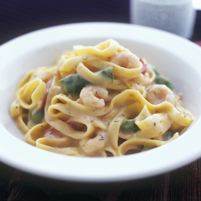 Tagliatelle with shrimps, asparagus and dill cream sauce.