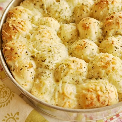 Garlic Cheese Pull-Apart Bread 16 frozen white dinner rolls (Rhodes brand) ½ C butter, melted 1 C grated Parmesan cheese, divided 1 tsp dry parsley flakes 1½ tsp garlic powder ½ tsp salt ½ tsp Italian seasoning ½ tsp onion powder. This bread is yummy!